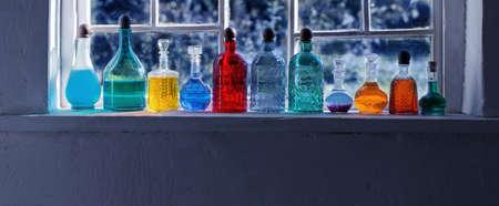 magic potions in bottles on windowsill Foto de archivo - 155696071