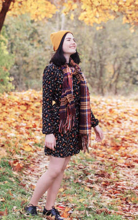 beautiful brunette girl in autumn park