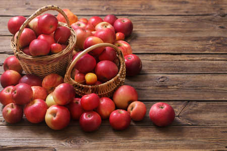 red apples on old wooden background
