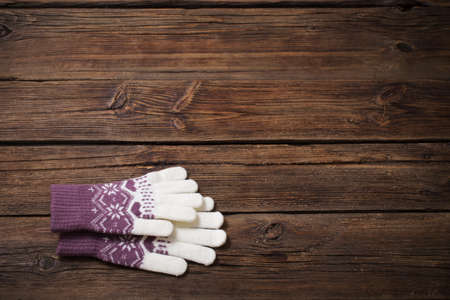 gloves on old wooden background Foto de archivo