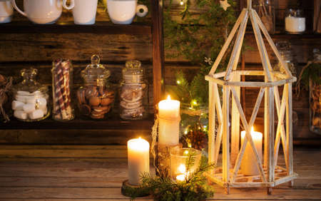 Christmas decoration cocoa bar with cookies and sweets on old wooden background in natural rustic style. Winter cozy concept