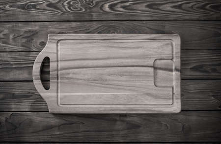cutting board on old wooden table 免版税图像