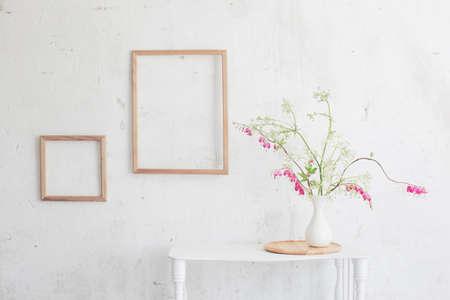 flowers in vase on background white wall 版權商用圖片