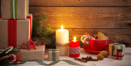 Christmas gifts and decorations on old wooden background