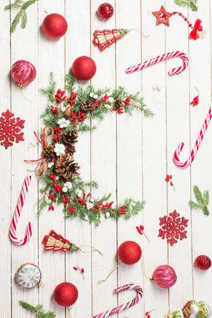 Christmas wreath on white wooden backdrop