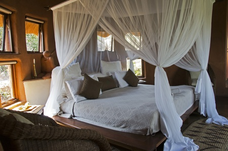 four poster bed: Four-poster bed in an African lodge Editorial