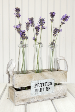 Three Small Vases With Lavender On A White Table Stock Photo