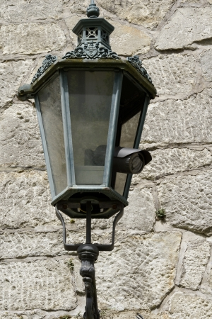 hidden danger: Surveillance camera hidden a an antique lantern Stock Photo