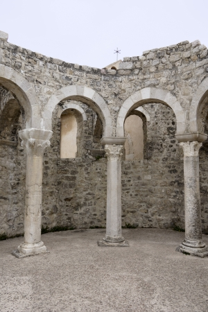 Roman arches in the town Rab on the island Rab in Croatia photo