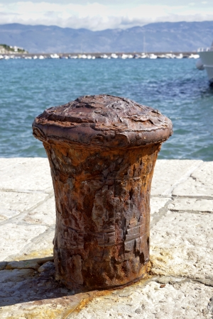 Beautiful old oxidated buoy in the harbour Stock Photo