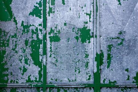 Detail of old green gray metal door Stock Photo
