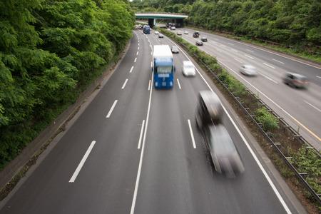 speeding: Cars speeding on motorway in Germany