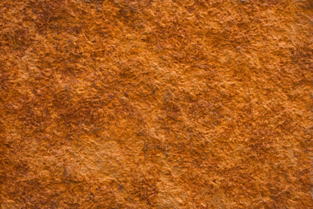 Background of a ocher natural stone wall