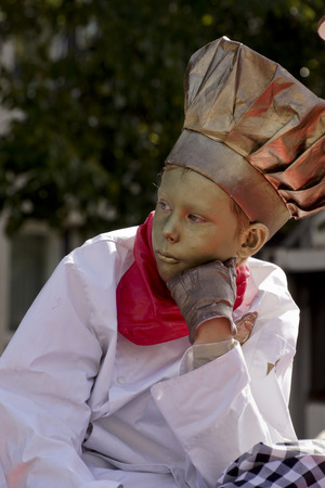 antiquary: ARNHEM; THE NETHERLANDS - 30 SEPTEMBER 2012; Boy performing as a living statue at the World Statues Festival in Arnhem; that is yearly held in Arnhem in The Netherlands