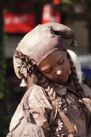 antiquary: ARNHEM; THE NETHERLANDS 30 SEPTEMBER 2012; Young woman performing as a living statue at the World Statues Festival in Arnhem; that is yearly held in Arnhem in The Netherlands Editorial