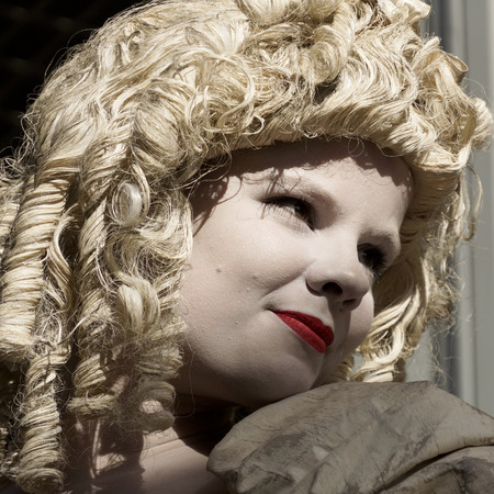 antiquary: ARNHEM; THE NETHERLANDS  30 SEPTEMBER 2012; Young woman performing as a living statue at the World Statues Festival in Arnhem; that is yearly held in Arnhem in The Netherlands