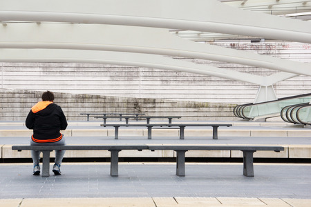 liege: Man sitting on a bench in the train station of Liege