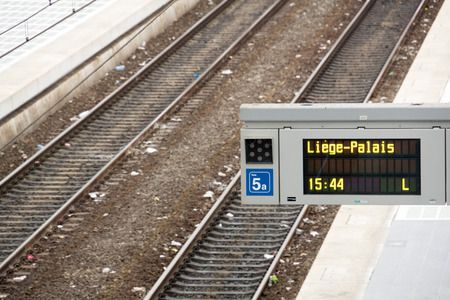 railtrack: Railtrack with information sign about train to Paris Stock Photo