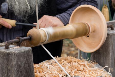 wood turning: A  man turning wood on a lathe Stock Photo