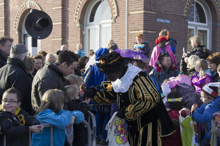 zwarte piet: WINTERSWIJK, HOLLAND 16 NOVEMBER 2013: Santa Claus Sinterklaas and Zwarte Piet arriving in Winterswijk, The Netherlands