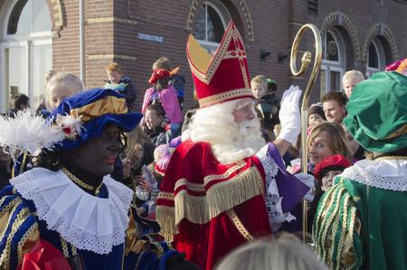 zwarte piet: WINTERSWIJK, HOLLAND 16 NOVEMBER 2013: Santa Claus Sinterklaas and Zwarte Piet arriving in Winterswijk, The Netherlands