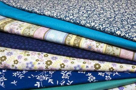 fabric textures: Pile of blue cotton fabrics