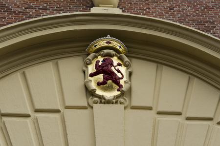 orange nassau: The Dutch coat of arms above a door in the Binnenhof in Th Hague