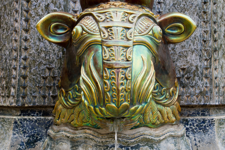 manufactured: PECS, HUNGARY 27 JUNE 2015  Artwork on a fountain in the main square in Pecs Hungary.  The sculpture was manufactured by Zsolnay in blue, green, purple metallic colored pottery. Photo taken on: 27 June 2015