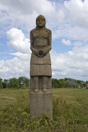 Stone statue at ancient Kun burial site of the plains people in Karcag. Stock Photo