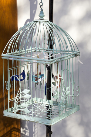 Decorative bird cage hanging outside