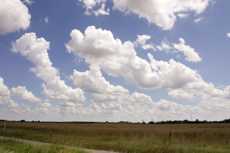 Beautiful blue sky with clouds in the Great Hungarian Plain 스톡 콘텐츠