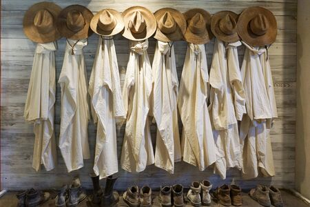 Row of historical robes, hats and shoes of Trappist monks in Conyers, Georgia, USA Stock fotó