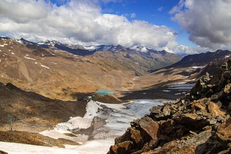 Panoramic mountain landscape of venter tal in the ötztal alps on the frontier from italy to austria, seen from summit grawand; glacier melt climate change concept