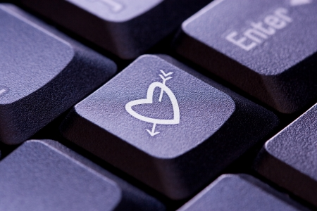Heart and Arrow Symbol On A Computer Keyboard Stock Photo