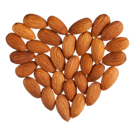 Almond heart isolated on white background photo