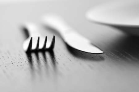 Knife, fork and plate in B&W photo