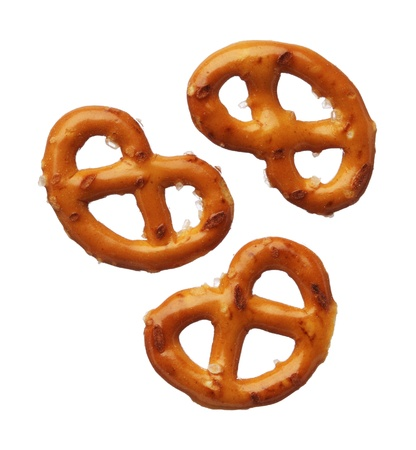 Three pretzels isolated on white background, close-up photo
