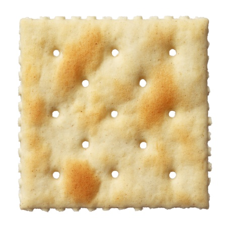 Saltine soda cracker isolated on white background
