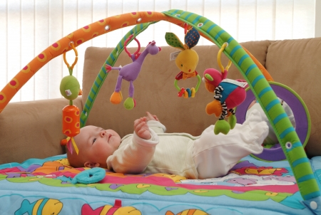 A baby is playing with toys. photo