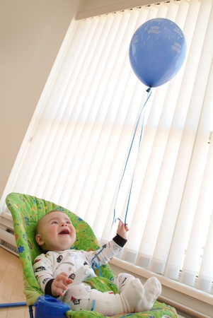 baby is having fun with balloon