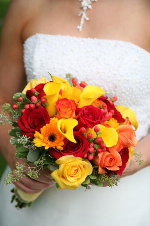 Bride is holding beautiful colorful bouquet  photo