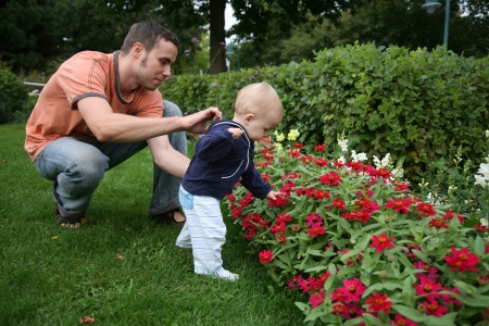 Father and Son outside smelling the flowers photo