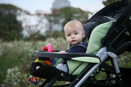 aloneness: Baby sitting in a stroller outside