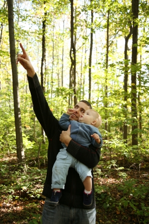 Father is teaching son about nature in the forest  Reklamní fotografie