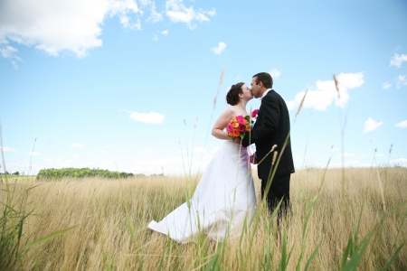 Bride and Groom kissing and hugging photo