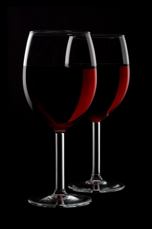 shot glass: Two glassed of red wine isolated on black background Stock Photo