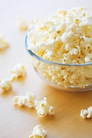 popcorn bowls: Glass bowl full of popcorn