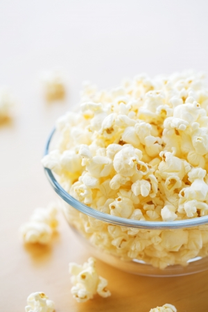 bowl of popcorn: Glass bowl full of popcorn