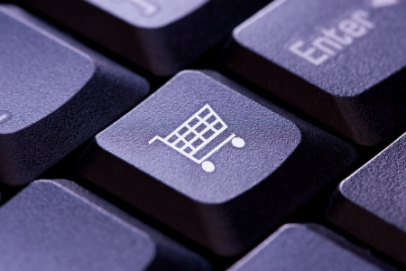 Shopping cart icon on a computer keyboard key photo