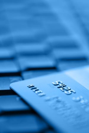 bank card: Bank Credit Card on a Computer Keyboard Stock Photo